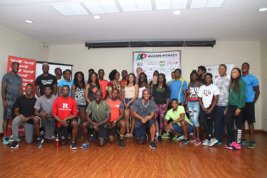 The athletes competing in today's Aliann Pompey Invitational pose for a photo yesterday at the Princess Ramada Hotel.