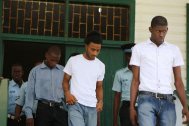 Leaving the courtroom, from left to right: Dameion Millington, Nicolas Narine and Warren McKenzie after they were found guilty by Magistrate Zamilla Ally-Seepaul in the robbery of Justice Nicola Pierre and her husband Mohamed Chan.