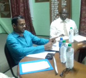 Chairman Vickchand Ramphal (centre) at the meeting