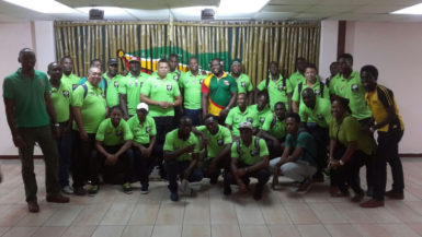 The victorious 'Green Machine' national rugby team pose with Director of Sport, Chris Jones and president of the union, Peter Green shortly after arriving at the Cheddi Jagan International Airport.
