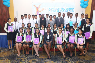 Minister within the Ministry of Education Nicolette Henry (front, centre) flanked by the successful graduates of the Republic Bank's Youth Link Apprenticeship Programme and staff of Republic Bank Guyana Limited including Managing Director Richard Sammy.