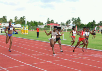 Guyana's fastest female athlete, Brenessa Thompson (lane 5) on her way to breaking the national 100m record on Saturday at the Aliann Pompey Invitational