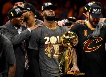 Cleveland Cavaliers forward LeBron James celebrates with the Larry O'Brien Championship Trophy after beating the Golden State Warriors in game seven. (Reuters)