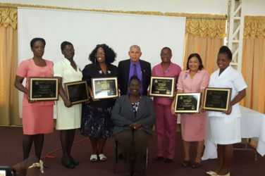 Public Health Minister, Dr. George Norton (standing at centre) with representatives of the six hospitals which attained Baby-Friendly Hospital status. Seated at centre is Senior Nutritionist, Ninian Blair. (Ministry of Public Health photo)