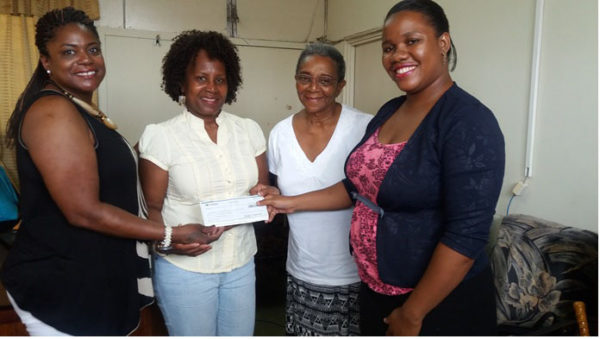 From left are Rebecca Miskiri-Antoine, Delores Collins and Joycelyn Thompson, members of the Baveghems family. Also in picture is Daniella King (right), Assistant Registrar-Students' Welfare, UG.