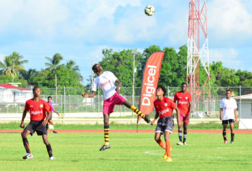 Action between Xenon Secondary (white) and Friendship Secondary in the Digicel Schools Football Championship at the Leonora Sports Facility