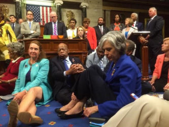 "A photo shot and tweeted from the floor of the U.S. House of Representatives by U.S. House Rep. Katherine Clark shows Democratic members of the House staging a sit-in on the House floor ""to demand action on common sense gun legislation"" on Capitol Hill in Washington, United States, June 22, 2016. REUTERS/ U.S. Rep. Katherine Clark/Handout"