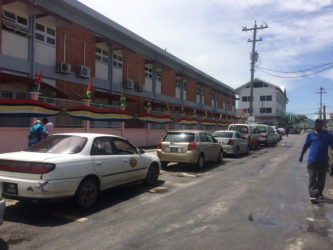 Vehicles parked outside of the Georgetown Public Hospital