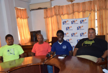 Vice President of the GRFU, Joshua Griffith (centre) makes a point during yesterday's press briefing. Griffith is surrounded by Coach of the U-19 team, Troy Yhip (right) and coach of the senior team, Laurie Adonis (second from left).