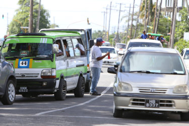 A water vendor attending to his customers at Lamaha Street and Vlissingen Road (Photo by Keno George)