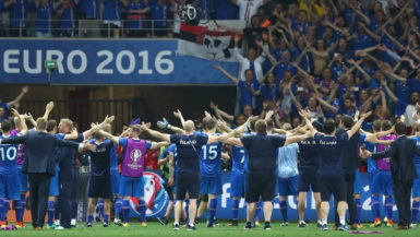 Iceland's victorious players celebrate with their fans after the final whistle.