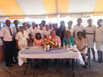 President of FACES, Sabrina Kazim (sitting at  left), Chairman of the Board of Directors of the GPHC, Max Hanoman (seated second from left), Collene Hicks, Director of Nursing in Guyana (seated second from right) and Customer Care Consultant, Joyce Sinclair (seated at right) flanked by the nurses who were recognised for their stellar performance.