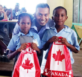Devindra Singh with two of the pupils