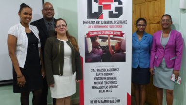 Clarence Perry (second from left) and Melissa De Santos (third from left) with other staff at the launching