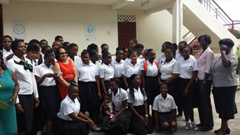Staff and students of the Mercy Wings Vocational Centre share a 'photo op' with First Lady Sandra Granger