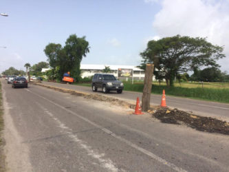The ongoing construction in the middle of Carifesta Avenue. The pole in the middle marks where lights will be installed.