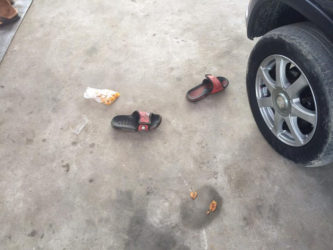 Jahmaul Lewis' footwear and the plantain chips he was eating, left on the ground after he was shot