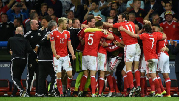 The Wales players celebrate their upset quarter-final win.
