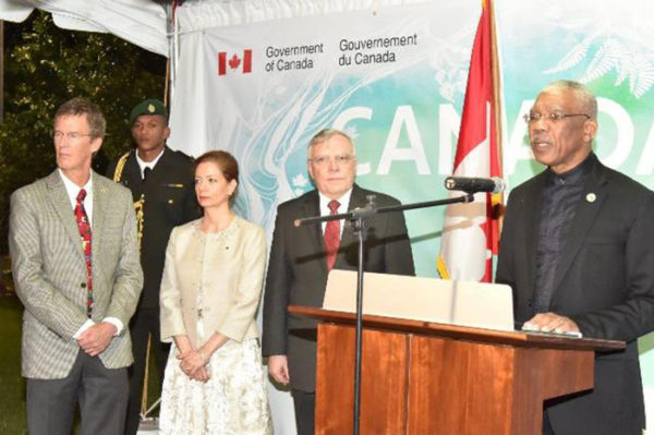 President David Granger addressing the attendees at the 'Canada Day' reception, which was held, on Friday evening, at the High Commissioner's residence. High Commissioner Pierre Giroux and his wife Blanca are next to him. (Ministry of the Presidency photo)