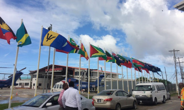 Flag welcome: Flags belonging to CARICOM nations were hoisted at the Eugene F. Correia International Airport yesterday as Guyana prepares to co-host the 37th Regular Meeting of the Conference of Heads of Government of the Caribbean Community which begins today.