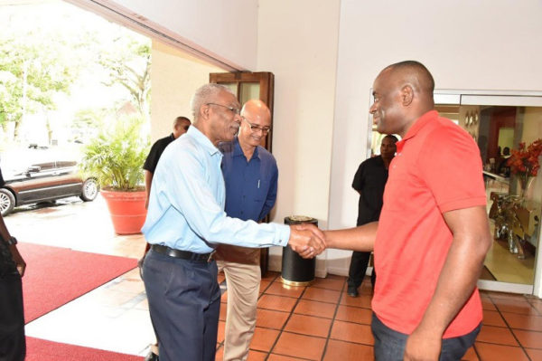 President David Granger (left)  shaking hands with Dominican Prime Minister Roosevelt Skerrit upon his arrival at the Pegasus Hotel, yesterday morning, for a breakfast meeting. (Ministry of the Presidency photo)