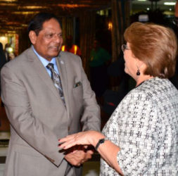 Prime Minister Moses Nagamootoo greets Chilean President Michelle Bachelet at the CJIA (GINA photo)