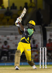 Superstar Chris Gayle hits out during his unbeaten 108 against Trinbago Knight Riders on Monday night. (Photo courtesy CPL)