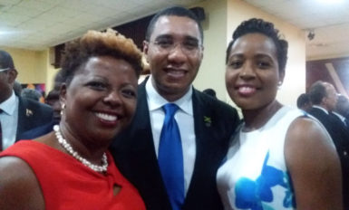 Cecile Watson (left) andValrie Grant (right) with Prime Minister of Jamaica Andrew Holness