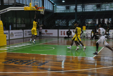 Dominick Bridgewater in the process of scoring an uncontested layup during his side's easy win over Dominica in the Caribbean Basketball Confederation (CBC) Boys u16 Championship at the Cliff Anderson Sports Hall.