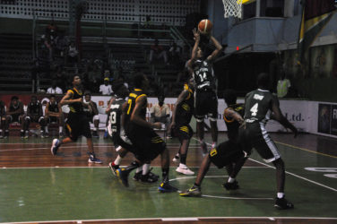 Guyana's Jordan Alphonso attempting a jump shot amid several Jamaican players during their matchup in the Caribbean Basketball Confederation (CBC) Boys u16 Championship at the Cliff Anderson Sports Hall.