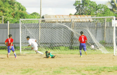 Kenbert Salvador (centre) in the process of celebrating after scoring the opening goal during their side's lopsided win over Aishalton in the Digicel Schools Foot Championship David Coates (left) off to celebrate his second goal against Aishalton Secondary in the Digicel Schools Football Championship