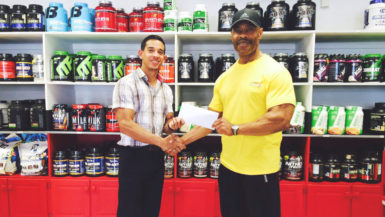 GABBFF, VP, Hugh Ross (right) receiving the sponsorship cheque from Fitness Express' CEO, Jamie McDonald on Thursday at the company's 47 John and Sheriff Streets location.