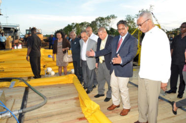 President David Granger, together with Gaico's CEO, Komal Singh and other dignitaries examining the equipment that would be used to skim the oil during a spill