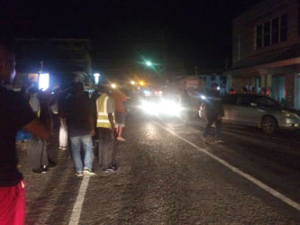 Police on the scene last night in front of Demerara Bank on Camp Street and South Road after the shooting.