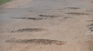 A section of the damaged road