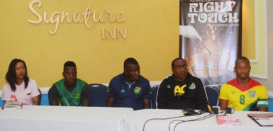 Members of the head table at yesterday's press briefing. Golden Jaguars captain Chris Nurse is at right while Guyana Head-Coach Jamaal Shabazz is second from right), Jamaica Head-Coach Theodore Whitmore is at centre and Reggae Boyz Captain Jevaughn Watson second from left. (Orlando Charles photo)
