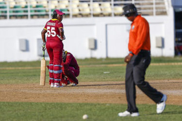 Erva Giddings (standing) stares in disappointment after being given out LBW in the opening ODI against England Women last Saturday. Shemaine Campbelle (stooping) shares in her disappointment. (Photo courtesy WICB Media)