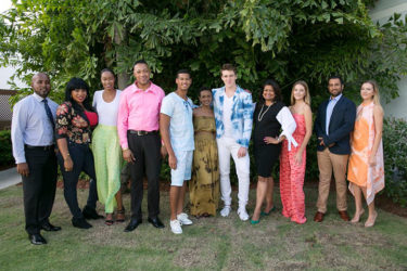 Supriya Singh-Bodden (fourth from right) and Anthony Autar (left) with the models
