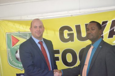 Deal sealed-recently appointed GFF Technical Director Englishman Ian Greenwood (left) shaking hands with GFF Chief Wayne Forde following the conclusion of his first press conference to signal his start to life in Guyanese football