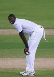 Fast bowler and West Indies Captain Jason Holder offers a wry grin as Pakistan pile on the runs during the second day of the day/night opening Test yesterday. (Photo courtesy WICB.