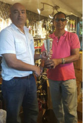 In picture President Oncar Ramroop (left) receives a trophy – the symbol of Trophy Stall's sponsorship – from Mr. Ramesh Sunich, CEO of Trophy Stall.