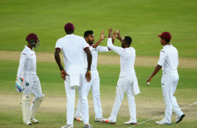 DUBAI, UNITED ARAB EMIRATES Devendra Bishoo of the West Indies celebrates with his teammates after dismissing Sami Aslam of Pakistan during Day Four of the First Test between Pakistan and West Indies at Dubai International Cricket Ground yesterday in Dubai, United Arab Emirates. (Photo by Francois Nel/Getty Imag