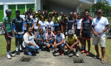 The cyclist and organizers share a photo following the race
