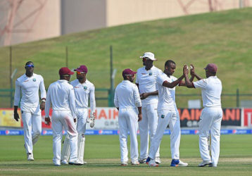 Fast bowler Miguel Cummins (second from right) celebrates West Indies' only wicket of the fourth day of the second Test. (Photo courtesy WICB Media)