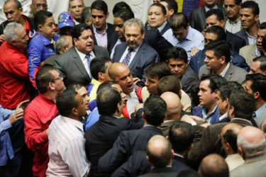 Deputies of the Venezuelan coalition of opposition parties (MUD) and of the Venezuela's United Socialist Party (PSUV) scuffle during a session of the National Assembly in Caracas, Venezuela October 25, 2016. (REUTERS/Marco Bello)