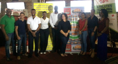 The sponsors and the organizers of the second annual GTM and the Guyana Fitness Games Health and Fitness Games pose for a photo last night following the launch at the 704 Sports Bar. The two-day event will be held at the Cliff Anderson Sports Hall starting from November 5.