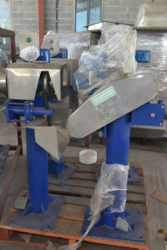 A Shell Remover that will help prepare the coconut for the production process.