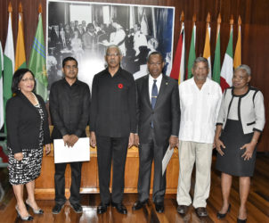 From left are Carol Corbin, Sukrishnalall Pasha, President David Granger, Ivor English, Nanda Kishore Gopaul and Emily Dodson at the Ministry of the Presidency yesterday after the swearing in ceremony. (Ministry of the Presidency photo)