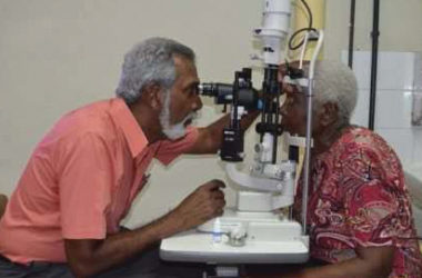 Dr. Deo Singh, Ophthalmologist performs an eye examination on one the patients benefitting from a corneal transplant (GINA photo)