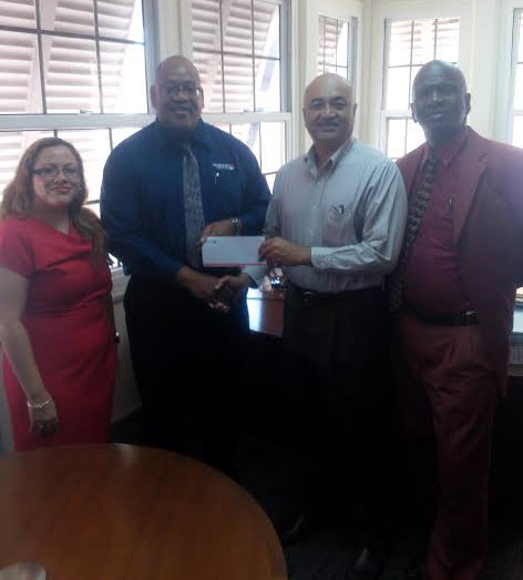Clarence Perry, Marketing Manager of the Demerara Mutual Group of Companies, hands over sponsorship cheque to Oncar Ramroop, Golf Club President. Left to right: Melissa Dos Santos, Legal Officer and Manager Demerara Mutual Fire & General Insurance, Perry, Ramroop and Guy Griffith, Public Relations Officer, Lusignan Golf Club.